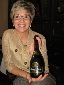 Sandra Hubner with Whitehall Agencies holding the Grand Cuvee
