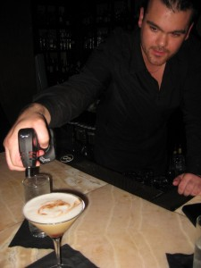 Shaun Layton torching his Creme Brulee Cocktail