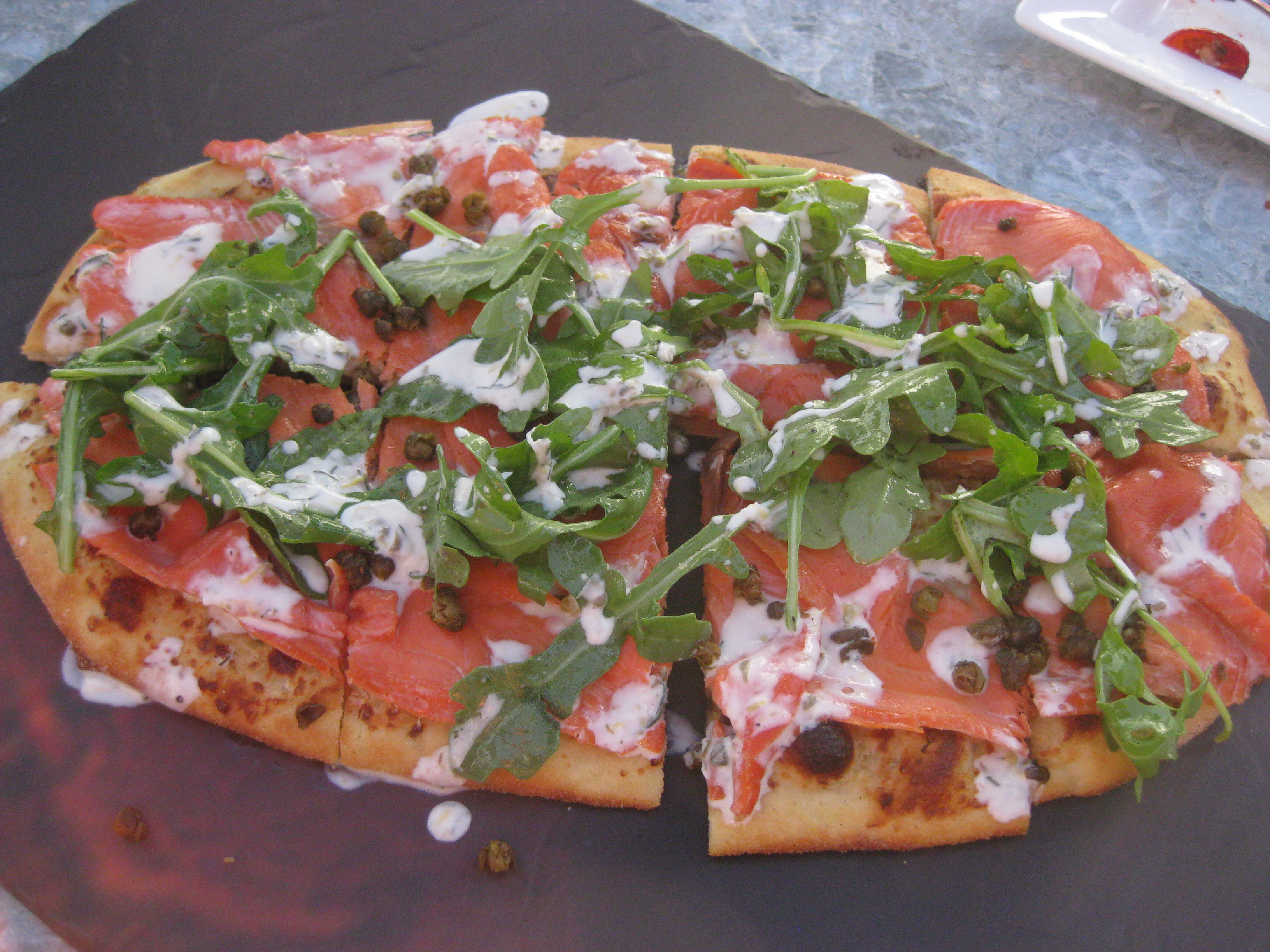 pizza topped with Smoked salmon, crisp capers, arugula, mascarpone ...