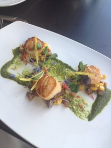 Stunning Scalliops with corn succotash with a fire roasted green pepper coulis