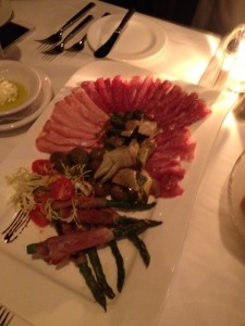 Prosciutto wrapped asparagus with antipasto