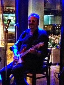 Ian playing electric guitar