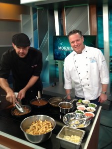 Chef Paul Mon-Kau and Chef Dino Renaerts coking up their poutine dishes on Global Morning News