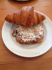 On the plate: Butter Croissant (back), Coconut Chocolate Croissant (front)
