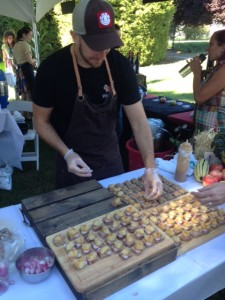 Chef Trevor Bird of Fable Kitchen serving Roof Top Radishes and Fable made cheese
