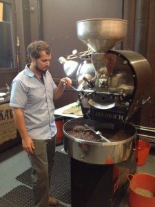 Blake Hanacek roasting coffee beans at AGRO Coffee Roasting