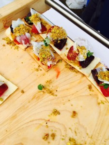 Compressed Strawberries with beet, black pepper jam, lardo and pistachio crumb from EBO Restaurant