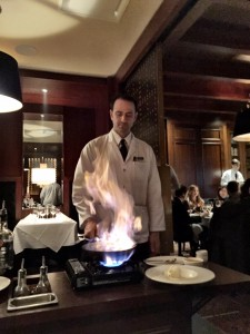 The server at Hy's Steakhouse playing with fire as he makes my Bananas Foster