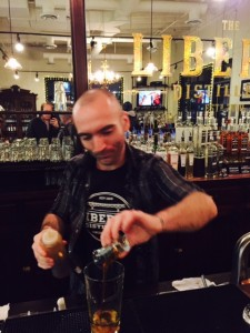 Andrew making the Last Spike cocktail