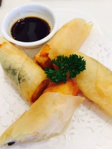 Shrimp, nori and pineapple filled spring rolls