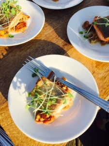 Bon Vivant Catering's House smoked and seared Salmon with farro and chanterelle risotto